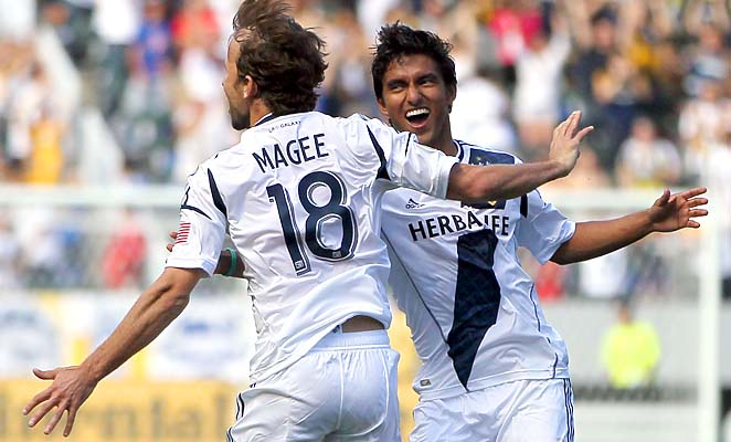 Mike Magee celebrates one of his three goals with A.J. DeLaGarza on Sunday.