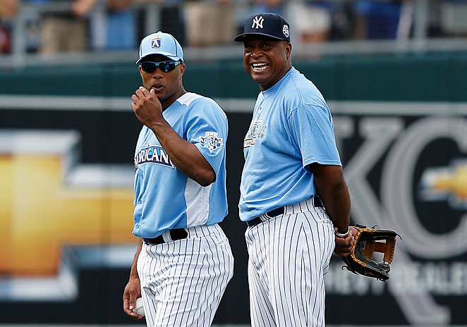 Jose Cano (right) says he expects the Yankees to re-sign his son, Robinson Cano, after the '13 season.