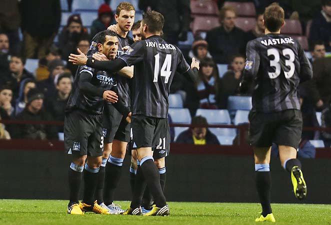 Carlos Tevez and Manchester City celebrate his goal in first-half stoppage time.