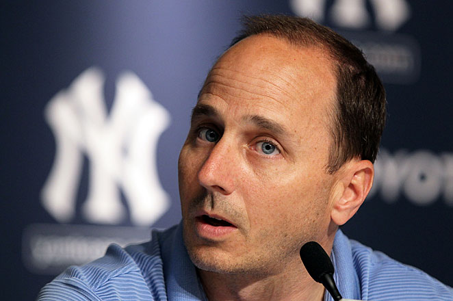 Yankees' general manager Brian Cashman broke his leg and dislocated his ankle skydiving in Florida.
