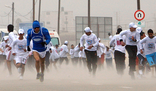 Runners brave the elements in the 2012 Gaza Marathon. The 2013 race was canceled for banning women from participating.