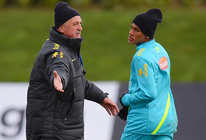 Coach Luiz Felipe Scolari converses with Neymar during a Brazil training session.