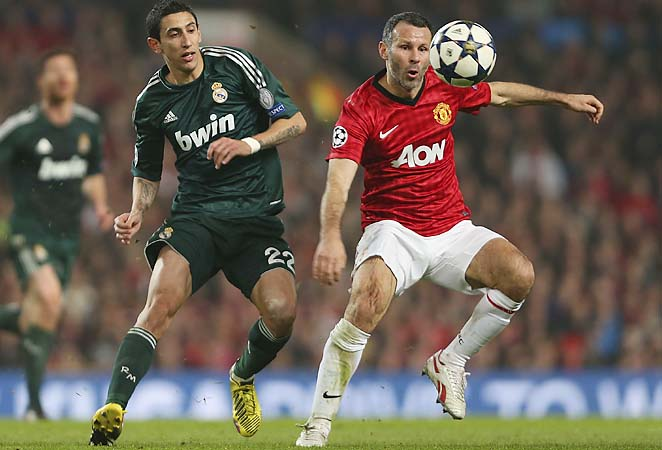 Ryan Giggs (right) controls the ball against Real Madrid in their Champions League match Tuesday.