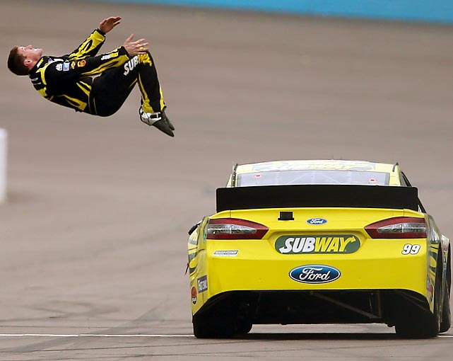 Carl Edwards does his trademark backflip from his No. 99 car to celebrate his victory in the NASCAR Spring Cup Series Subway Fresh Fit 500. The backflip was a long time coming for Edwards, who snapped a 70-race winless streak with the win one week after wrecking five cars at Daytona.
