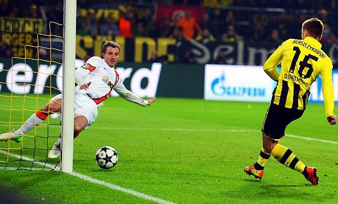 Jakub Blaszczykowski scores Borussia Dortmund's third goal in Tuesday's match.
