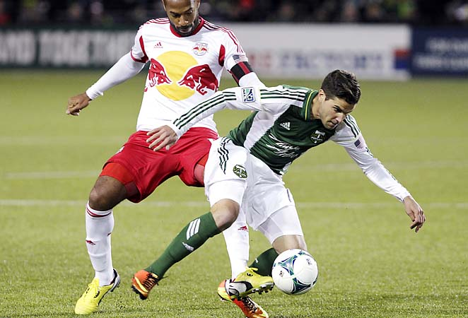 Sal Zizzo (right) steals the ball away from Thierry Henry in their season opener on Sunday.