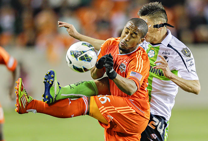 Corey Ashe and the Dynamo beat Santos Laguna 1-0 Monday at BBVA Compass Stadium in Houston.