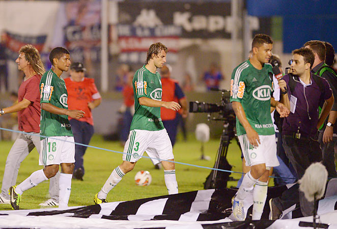 Palmeiras players exit the field after suffering a late 1-0 loss to Argentinian side Tigre in the Copa Liberatores Wednesday night.