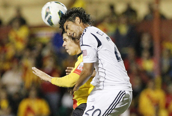 Galaxy defender A.J. DeLaGarza goes up for a header with Herediano's Cristian Montero in Thursday night's scoreless draw. Herediano missed a penalty kick in the 87th minute of the match.