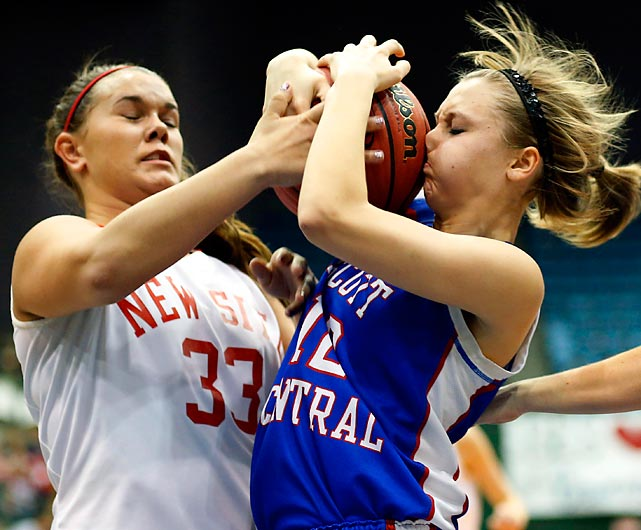 Scott Central's Watkins kisses the rock goodbye as she battles with New Site's Stricklen during their rollicking Mississippi Class 2A high school title game.