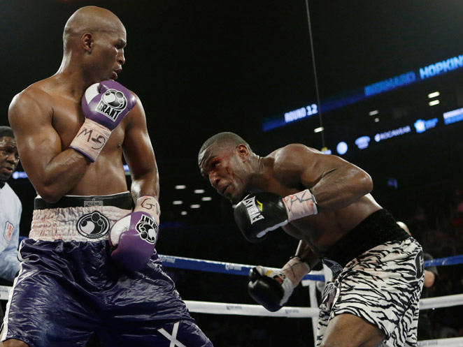 With his win over Tavoris Cloud, Bernard Hopkins (left) became the oldest boxer to win a major title.