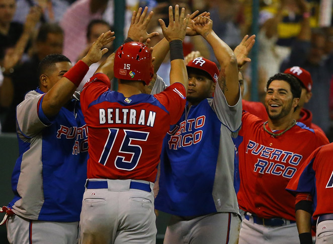 Carlos Beltran and Puerto Rico topped Venezuela, 6-3, to move on to the second round in the WBC.