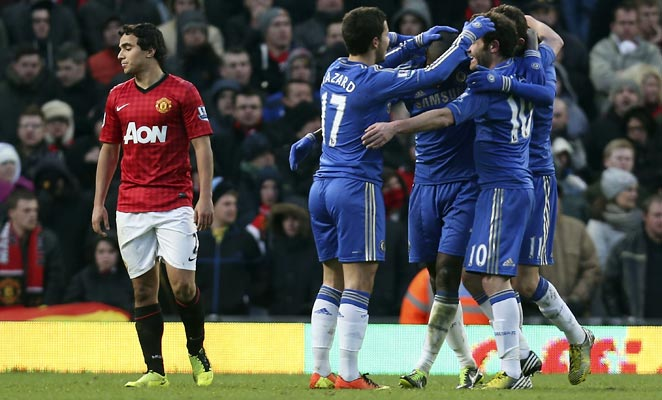 Chelsea players celebrate Ramires' game-tying goal in the 66th minute against Manchester United.