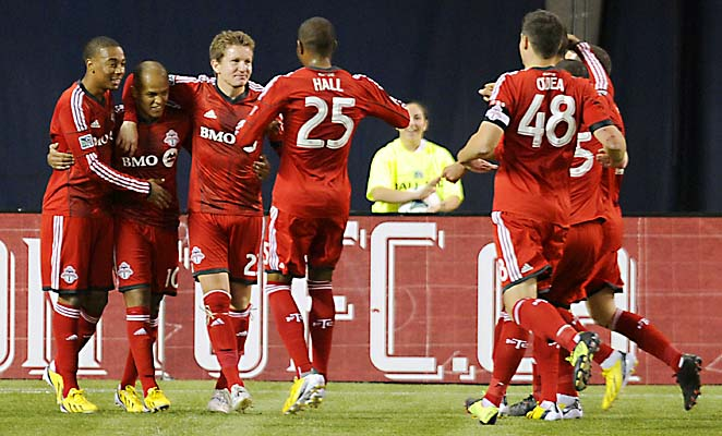 Toronto FC bounced back from an opening defeat at Vancouver by downing Sporting Kansas City 2-1.
