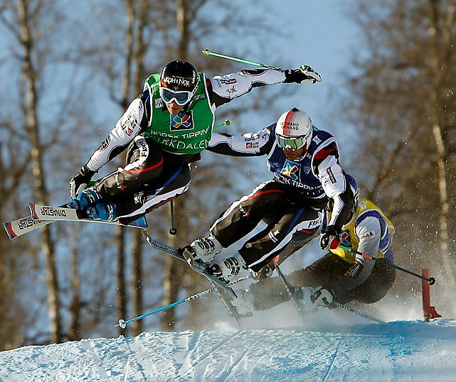 Jean-Frederic Chapuis leads Bastien Midol and John Teller in the snow cross competition at the FIS Freestyle Ski World Championships on the slopes of Myrkdalen in Voss, Norway. Jouni Pellinen took an early lead in the race but straddled a gate and was forced to move to the side of the course.