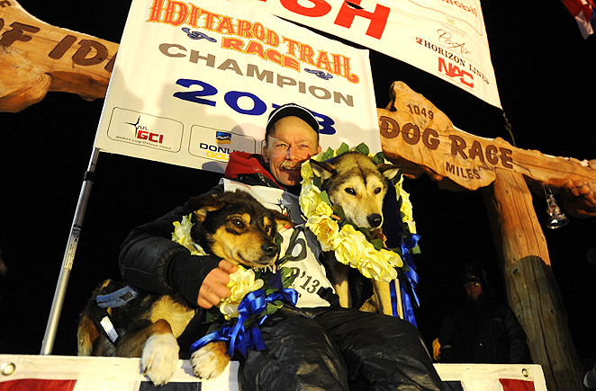 Mitch Seavey celebrates with his dogs after winning the 2013 Iditarod Trail Race.