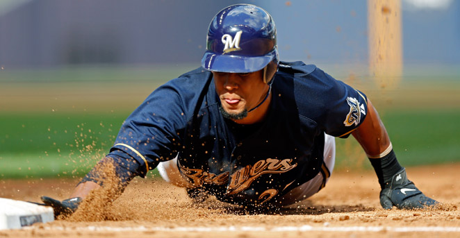 Carlos Gomez, who stole 37 bases last season, avoids free agency in signing a deal with Milwaukee.