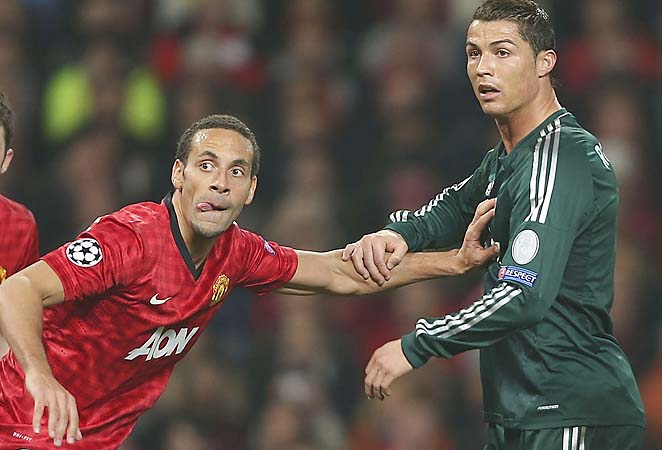 Rio Ferdinand defends Cristiano Ronaldo in their Champions League match.