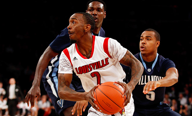 New York native Russ Smith scored 28 points at Madison Square Garden, turning in a complete performance hours after discovering his influential high school coach had passed away.