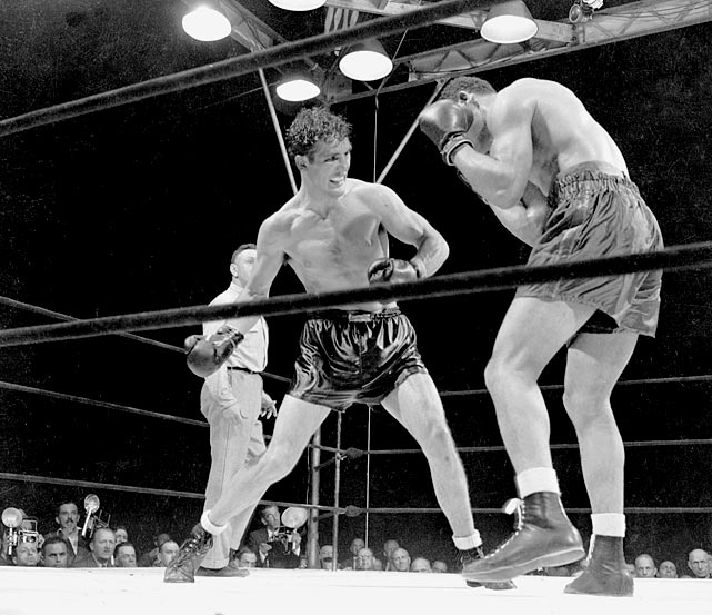 The Pittsburgh Kid held the title of light heavyweight champion for nearly a year between July 1939 and June 1940 and was named Ring Magazine's Fighter of the Year in 1940. Conn gave up his light heavyweight title to challenge Joe Louis for the heavyweight championship, attempting to become the first light heavyweight champion to jump to heavyweight champion. Conn didn't even go up in weight for the fight but was leading the fight after 12 rounds when he tried for a knockout in round 13 and got knocked out himself. He won 64 of his 77 career fights.