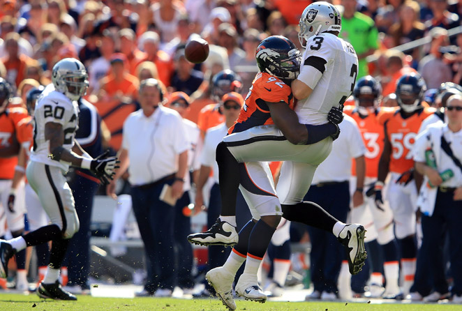 Elvis Dumervil (center) was second in sacks on the Broncos last year with 11 quarterback takedowns.