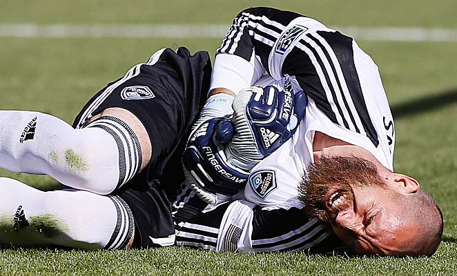 Matt Pickens writhes in pain after breaking his arm against Real Salt Lake on Saturday.
