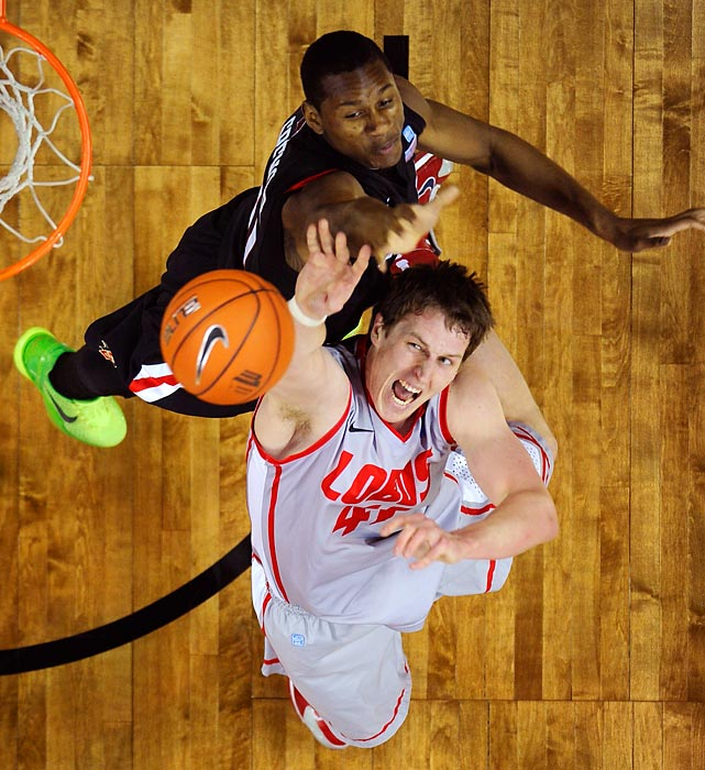 New Mexico forward Cameron Bairstow puts up a shot as San Diego State forward Skylar Spencer tries to deny him in the Mountain West Conference Tournament semifinal on March 15. Bairstow chipped in 16 points as the Lobos eliminated the Aztecs 60-50, advancing to the finals, where they beat UNLV for the tournament title.
