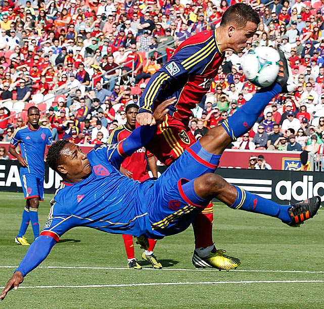 Colorado Rapids midfielder Diego Calderon knocks the ball away from Real Salt Lake midfielder Luis Gil during the first half of the MLS clubs' 1-1 draw. The match was part of the MLS' rivalry week, pitting the two teams for the first leg of the Rocky Mountain Cup rivalry series.