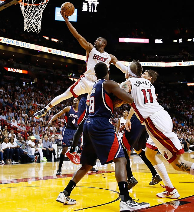 Miami Heat guard Dwyane Wade rises to the hoop for a layup against the Atlanta Hawks on March 12 in Miami. Wade scored a team-high 23 points in Miami's 98-81 victory, part of its now 22-game winning streak.