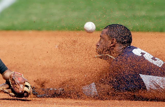 New York Yankees shortstop Eduardo Nunez steals third as Pittsburgh Pirates third baseman Pedro Alvarez misplays the throw in a March 17 spring training game in Bradenton, Fla. The Yankees won a slugfest 11-9, powered by home runs from Kevin Youkilis and Melky Mesa.
