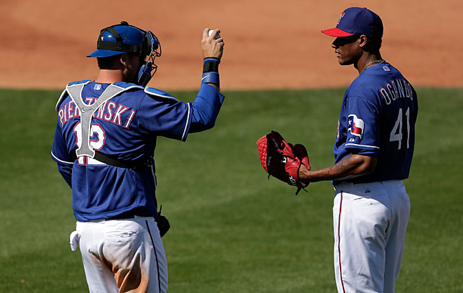 Newcomer A.J. Pierzynski (left) and holdover Alexi Ogando are among the players Texas will need to step up if it is to return to the postseason.