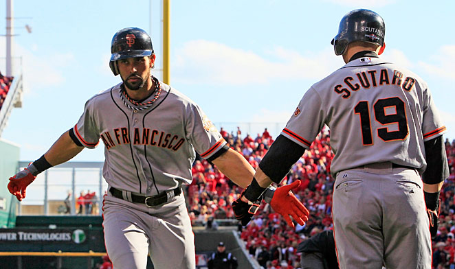 Angel Pagan and Marco Scutaro both returned to San Francisco as free-agents after helping the Giants win their second World Series in three years.