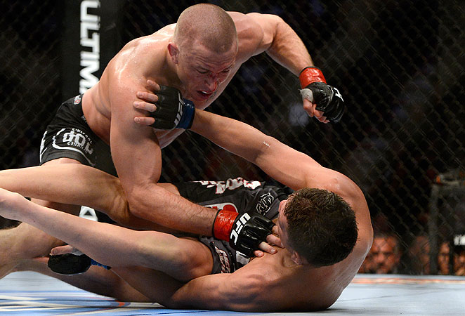 Though battered, Nick Diaz (bottom) criticized Georges St-Pierre's power during and after the fight.