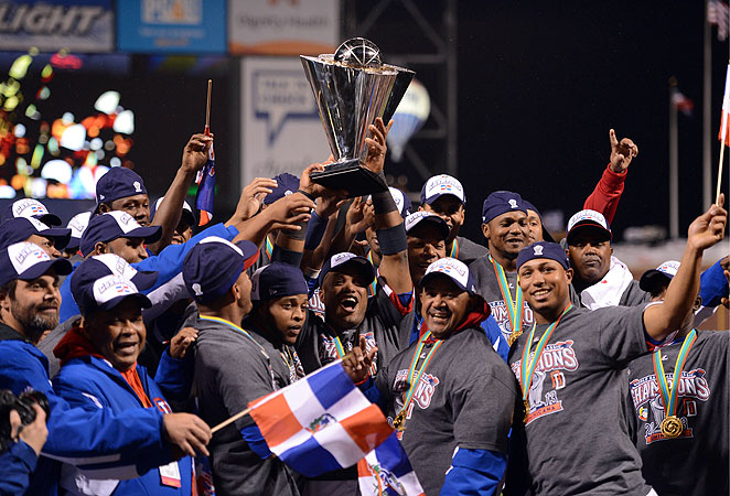 Robinson Cano (with trophy) won MVP honors at the WBC after batting .469 for the tournament.