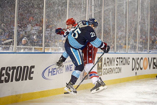 The game was a wet, sloppy affair with rain frequently creating puddles on the ice.