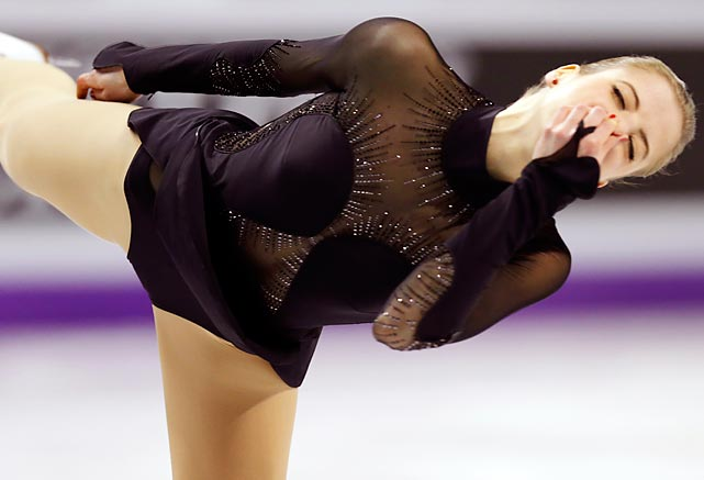 Italy's Carolina Kostner held her nose and did her duty during her performance in the women's free skate program in London, Ontario, but in the end the judges begged to differ and awarded her the silver medal.
