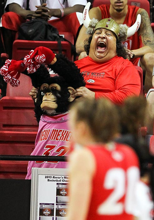 "As an obscure group of musicians from Liverpool, England once so truthfully sang, ""Everybody's got something to hide except for this New Mexico Lobos fan and his monkey."""