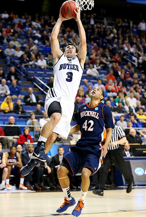 Alex Barlow rises above Cameron Ayers for a layup in Butler's 68-56 second round victory over Bucknell.