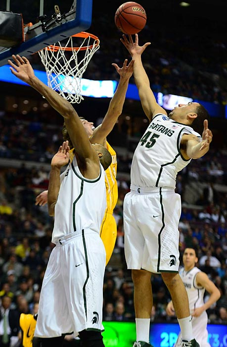Freshman guard Denzel Valentine stretches for a rebound as the Spartans took on Valparaiso in their tournament opener.
