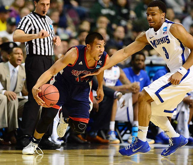 Stephen Holt tried going low to get past 6' 4'' Memphis guard Chris Crawford in Saint Mary's close second round game.