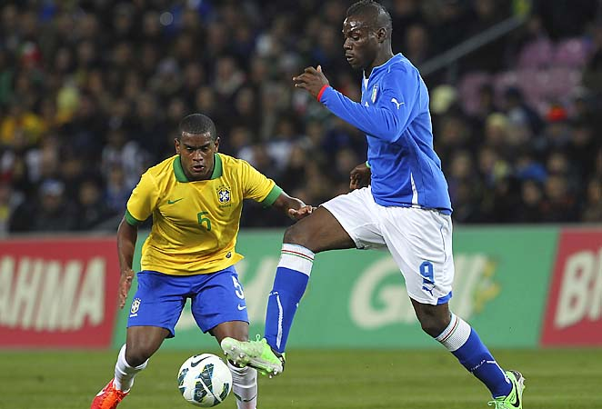 Mario Balotelli (right) scored in the 57th minute for Italy.