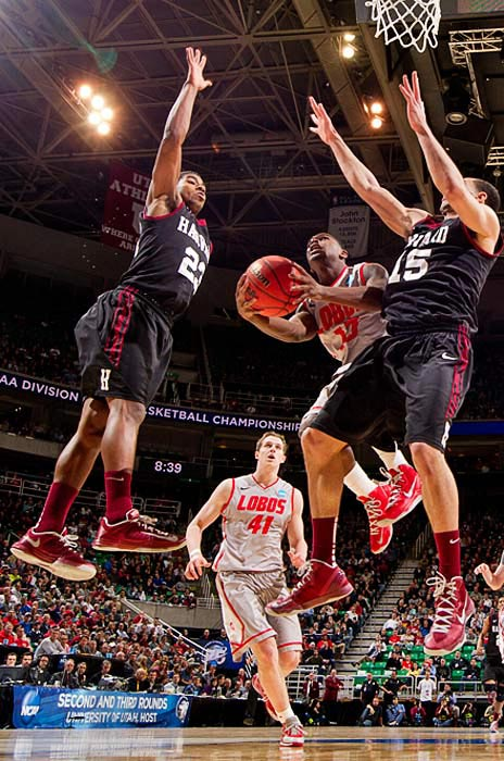 Harvard's first win ever in the tournament advanced it to a Saturday date against sixth-seeded Arizona.