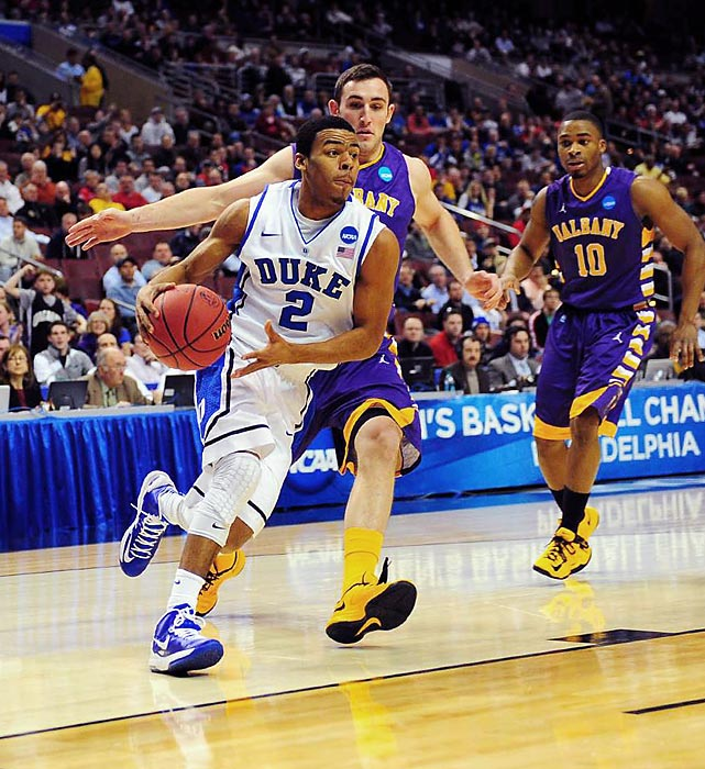 Duke guard Quinn Cook dashes through the Albany defense on his way to a game-leading nine assists.