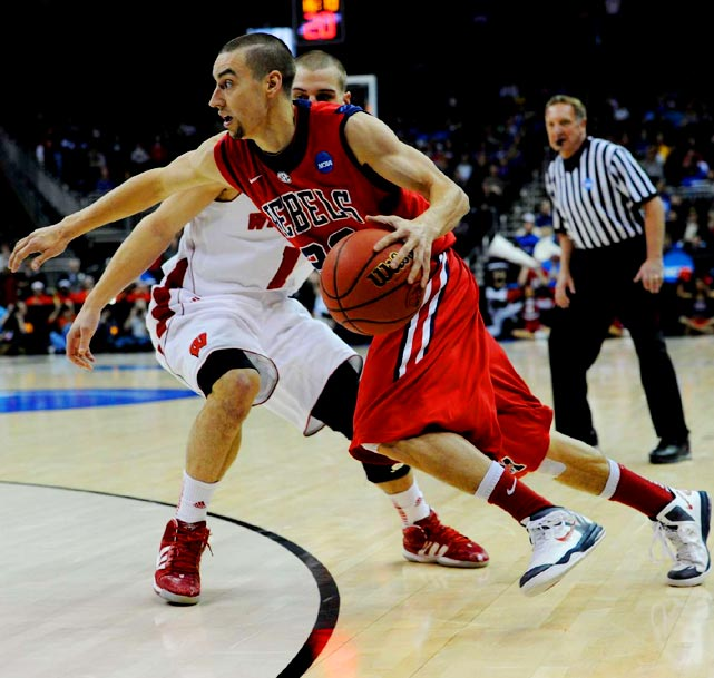 Marshall Henderson drives to the hoop in the Rebels' back and forth tournament opener against Wisconsin.