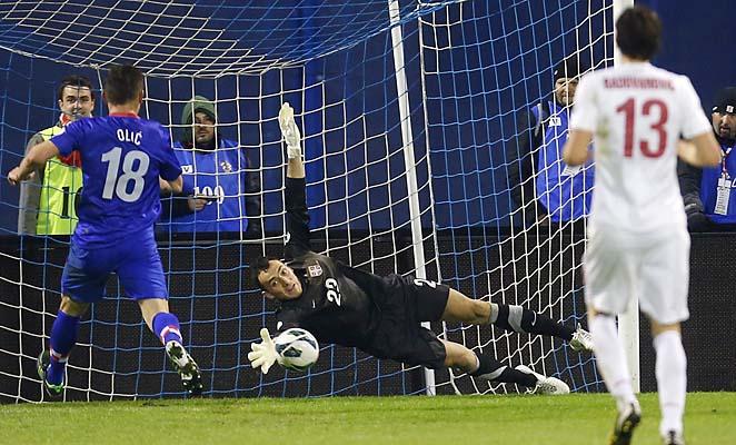 Serbia goalkeeper Zeljko Brkic makes a save in front of Croatia's Ivica Olic.