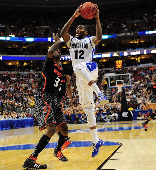 Bluejays guard Jahenns Manigat battles David Nyarsuk in the key to get a shot off in Creighton's 67-63 second round win against Cincinnati.