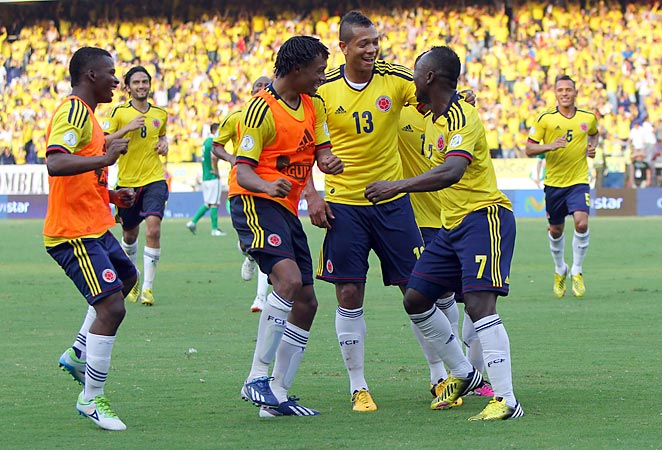 Colombia players celebrate one of their five goals against Bolivia in World Cup qualifying on Friday.