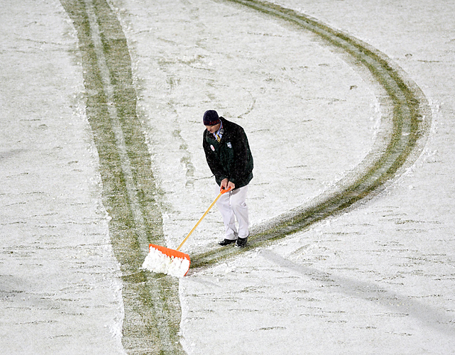 With snow falling throughout the match, field maintenance crews focused on keeping the field's lines visible by any means.