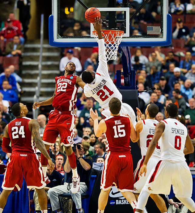 San Diego State's Jamaal Franklin tips in a basket over Oklahoma's Amath M'Baye. Franklin had 21 points in San Diego State's win.