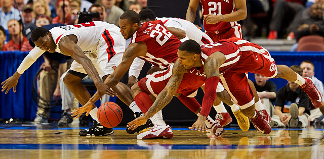 Oklahoma's Romero Osby, 24, and Amath M'Baye, 22, fight for a loose ball with San Diego State's DeShawn Stevens.
